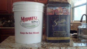 Here's the 7.9 gallon fermentation bucket next to the box containing the juice and grape skins
