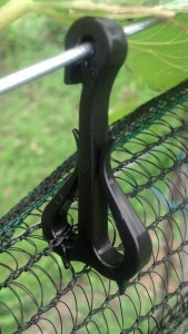The hooks that hold the netting to the catch wire.